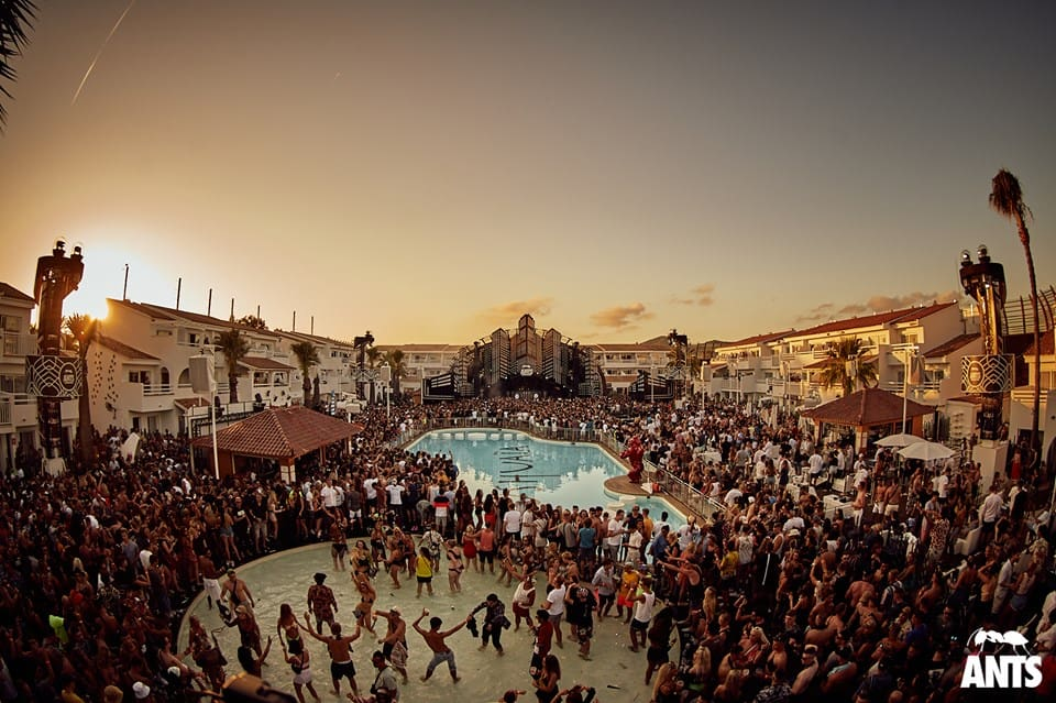 The sun sets at packed Ushuaïa Hotel Pool in Ibiza as the Ants Party gears up