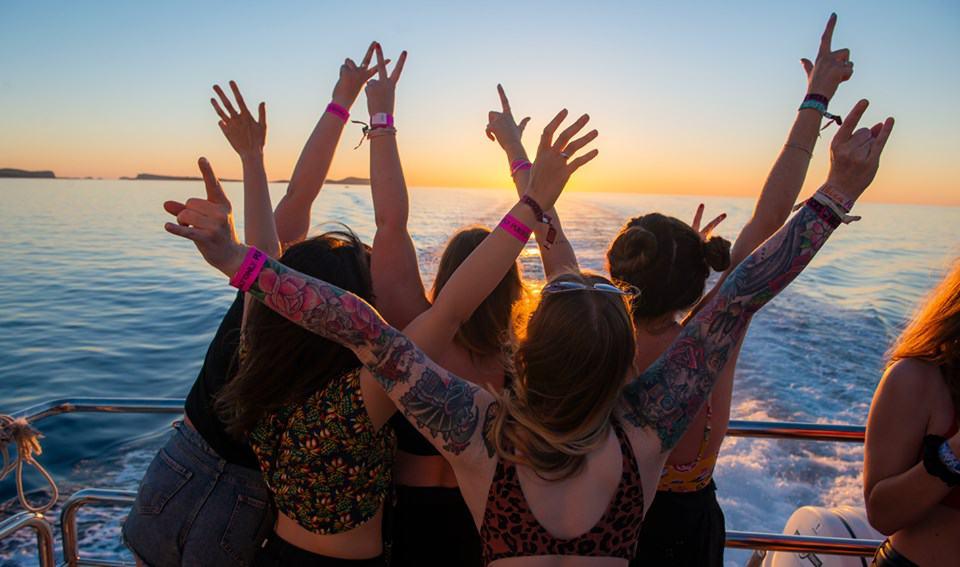 Group of girls emulating the Titanic scene on the Pukka Up Boat Party around Ibiza Island