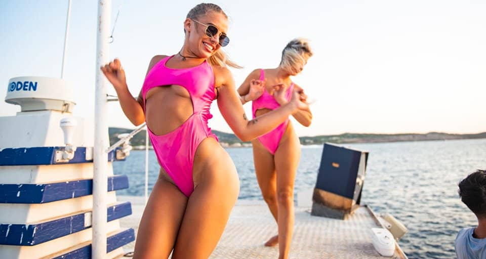 Exotic dancers performing on the Ibiza Pukka Up Boat Party