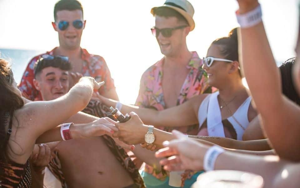 Girls give Lad Alchohol shots Having Fun Aboud the Ibiza Booze Boat