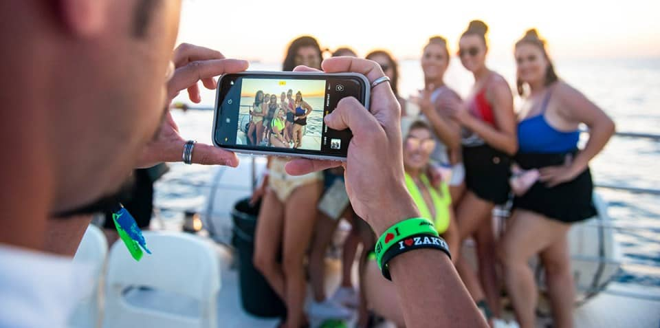 Lad takes Holiday Photo on Camerphone of Group of Girls on the Ibiza Pukka Up Boat Party