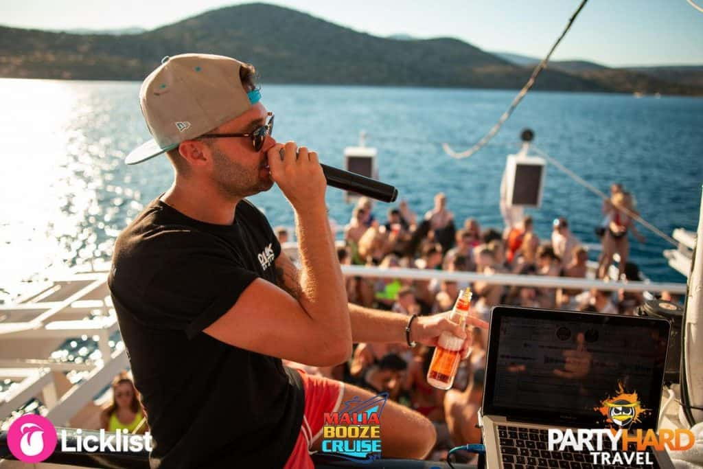 DJ Jak Bradley Chatting Over the Microphone to the Boat Party Revellers