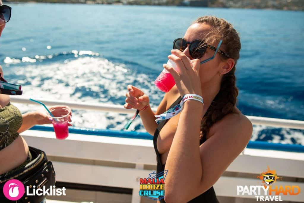 Girl Knocking Back the Cherry Cola on Deck of the Nostos Cruises Boat