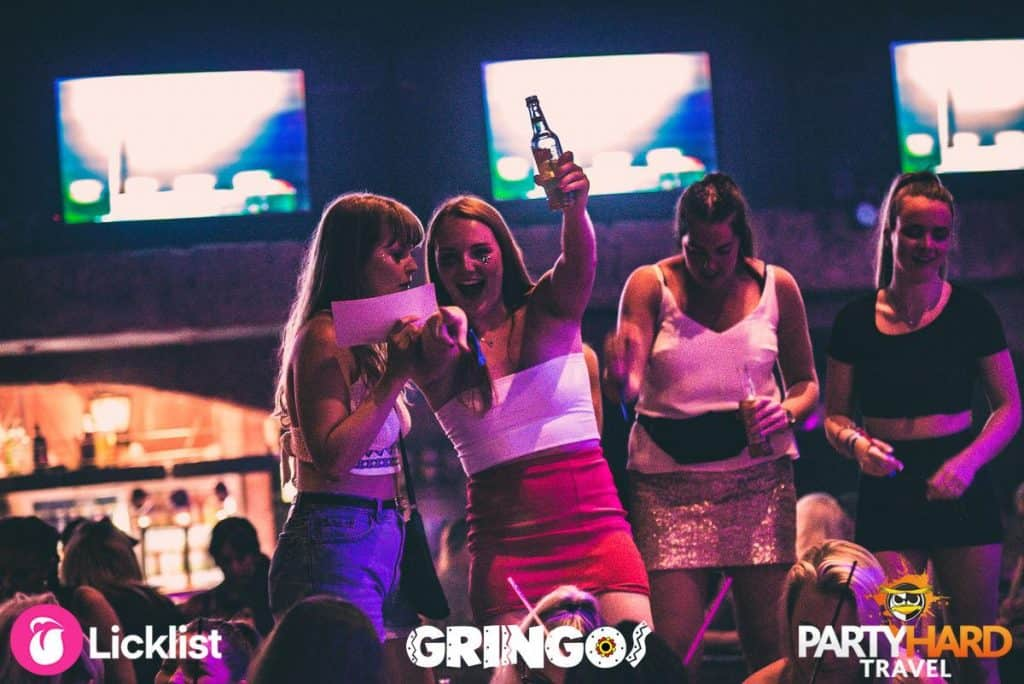 Girls discovered they've won at Gringos Bingo, in Malaga