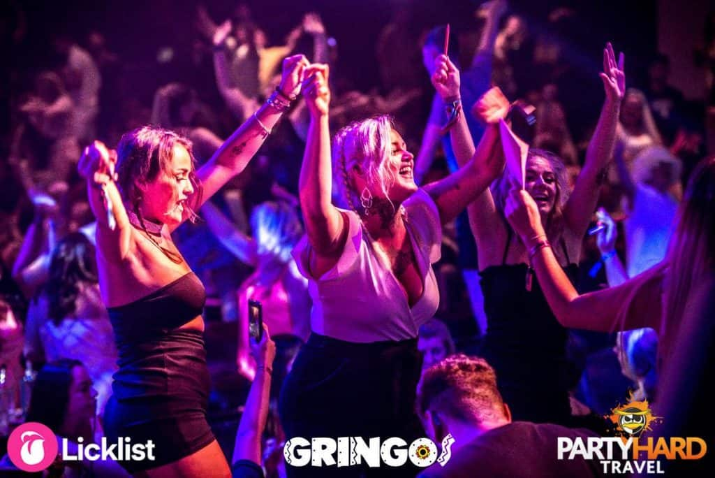 Group of Girls cheering on Table Tops at the crazy mixed up and wild night out in Gringos Bingo Club.
