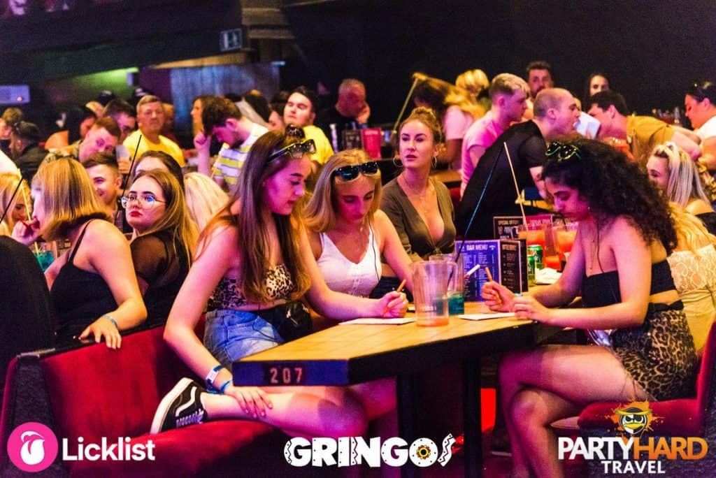 Girls deep in concentration checking their Bingo cards at Gringos Club in Magaluf