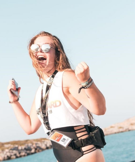 Elin Jones-Thomas, Party Hard Travel staff Rep with mobile phone and wearing sunglasses