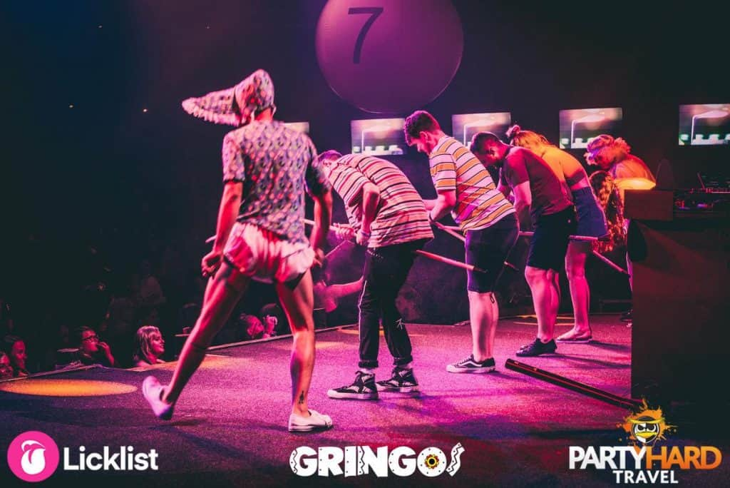 Lads participating in party games on the stage at Gringos Party Night