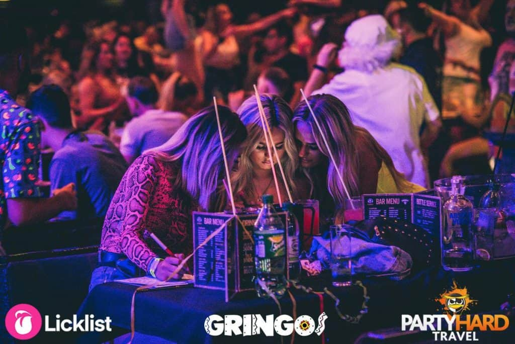 Three girls checking their bingo cards, have they won at Gringos? Magaluf