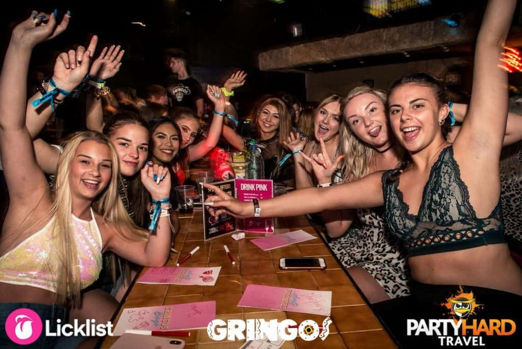 Girls sitting round the table looking forward to a good game of Bingo at Gringos Club
