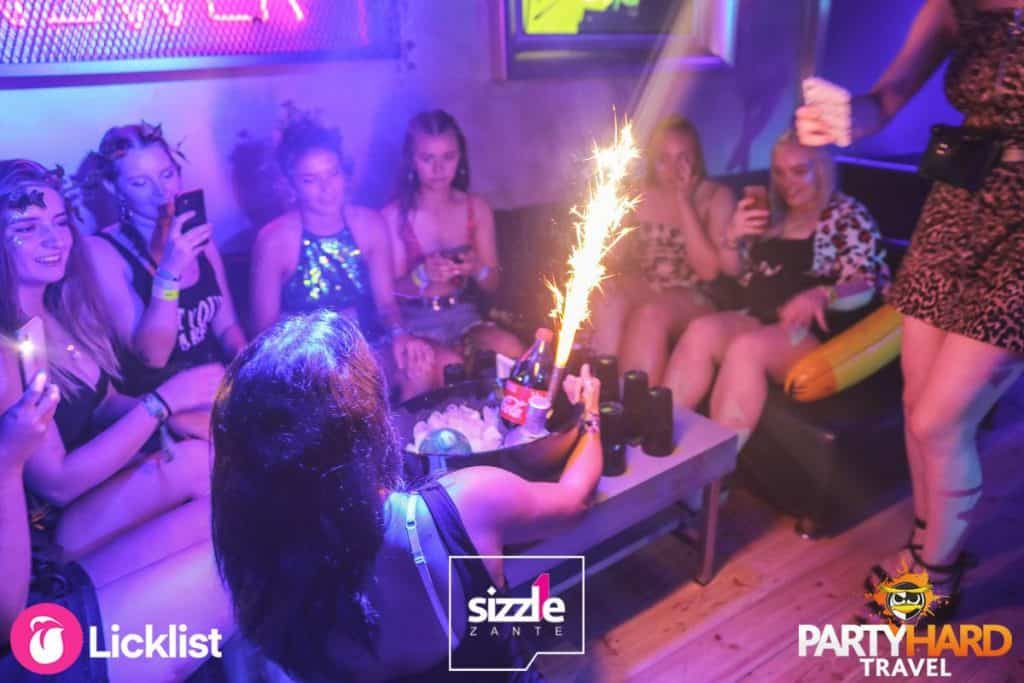 Girls at Sizzle club with drinks recording the firework display on their mobile phones