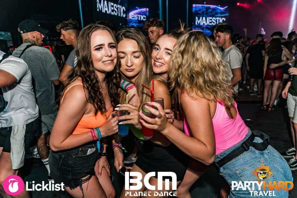 Girls gather for a chat with drinks in the early hours after a long night clubbing