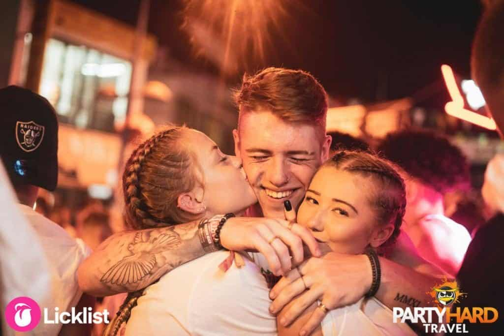 Lad with Tatoos finds Two Girl friends on the Ayaia Napa Party Street