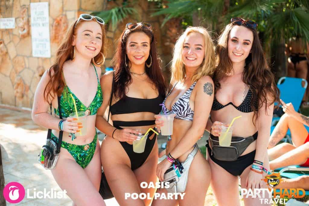 Malia Pool Party: Four Girls With Drinks posing for Holiday Photograph