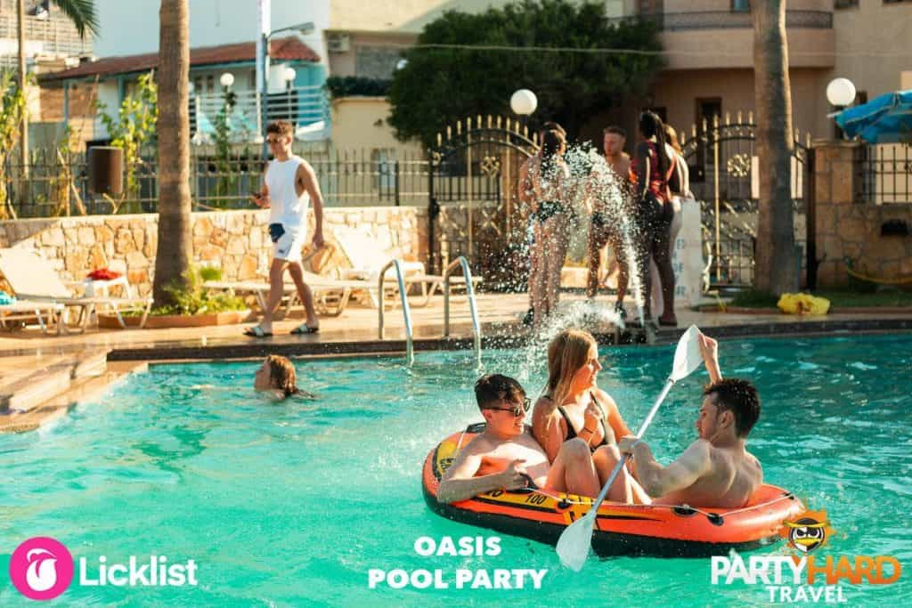 Two Lads and a Girl Floating in a Miniature Inflatable Dinghy in the Malia Oasis Pool