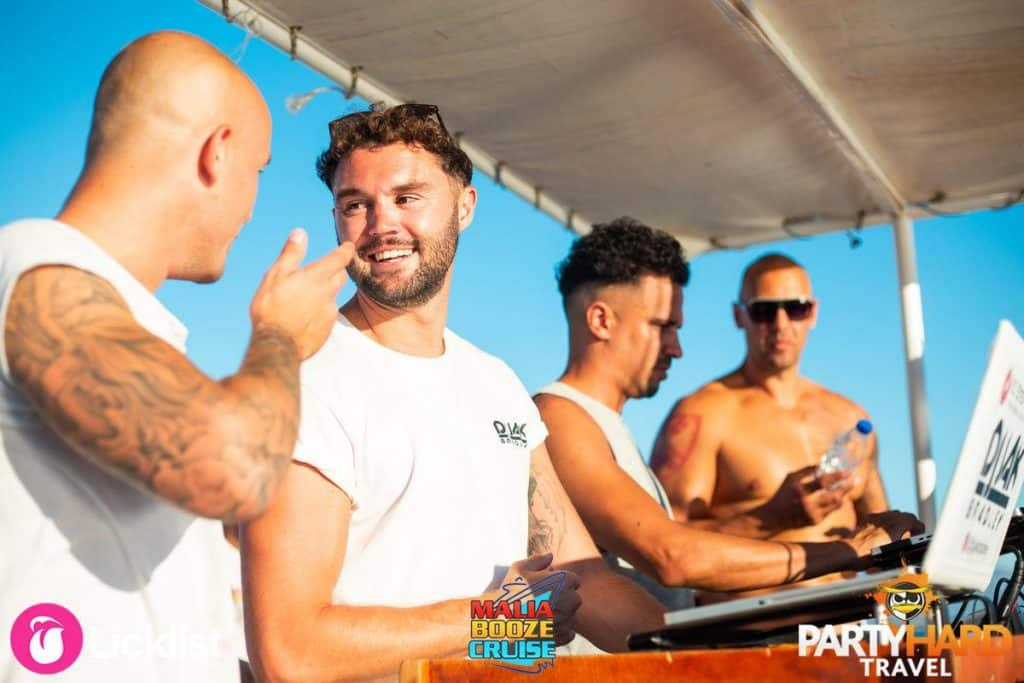 Top DJ Jak Bradley Chatting, While Darren Damour is at the Mixing Decks on the Malia Cruise
