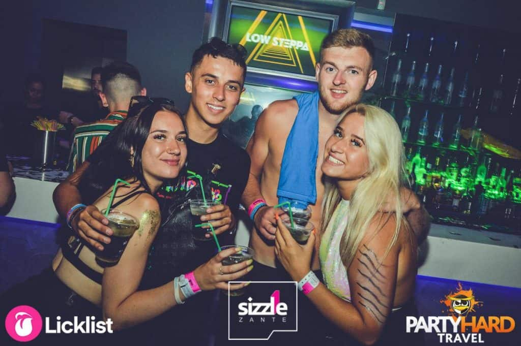 Group of Lads and Girls with Drinks at Sizzle Club Bar, Laganas in Zante