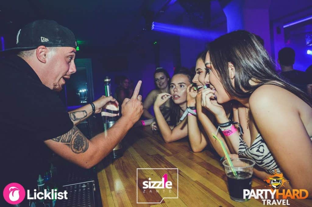Bar Man with Tatoos has the girls attention at Laganas Club