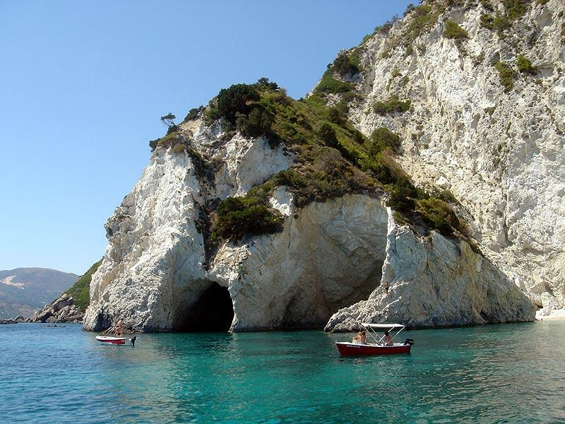 Boats visiting the private Cameo Island at Agios Sostis
