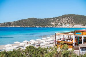 Sun Loungers and Parasols on Playa Den Bossa, Las Salinas Beach, Ibiza and Bar Restaurant