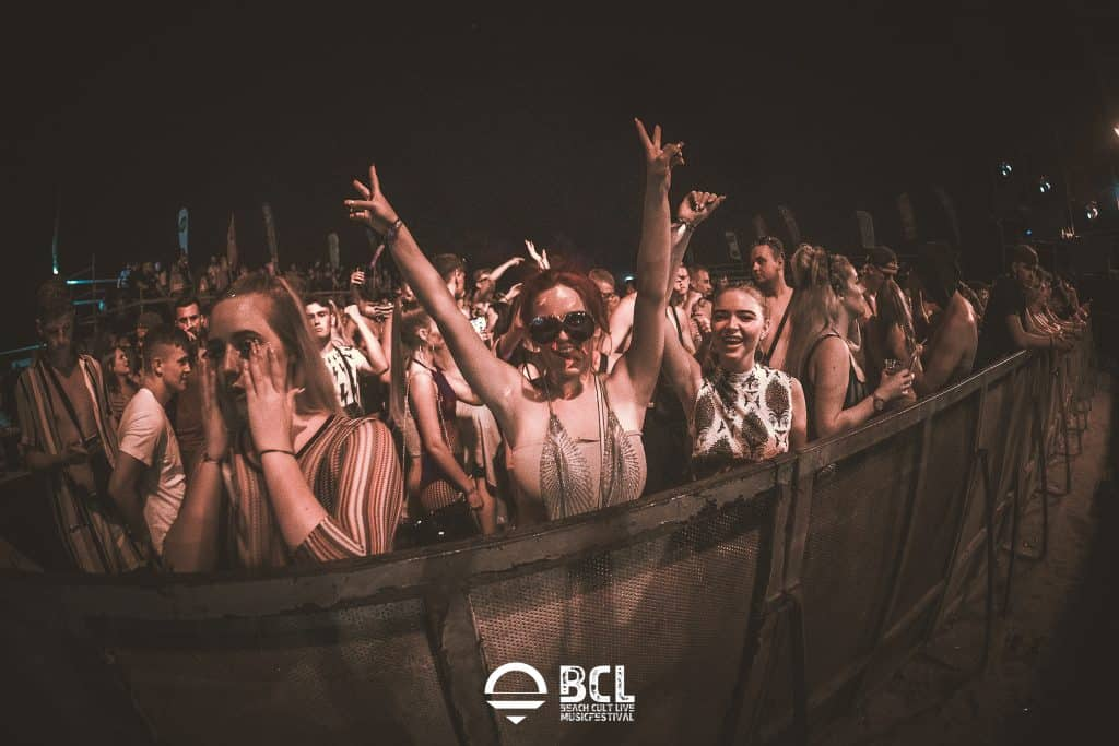 Girls Cheering behind Barrier at Beach Cult Live Festival