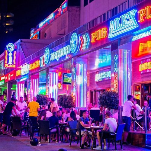 alex's bar on magaluf strip neon lights in nighttime