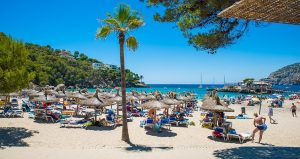 The beach at Camp de Mar, Magaluf and the wooden bridge to the rocky islet called 'La Illeta'