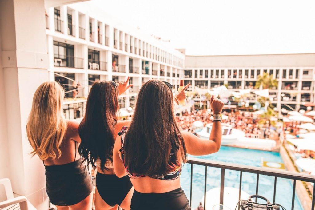 three girls on balcony ibiza rocks hotel