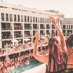 girls on rooftop overlooking pool party ibiza rocks hotel