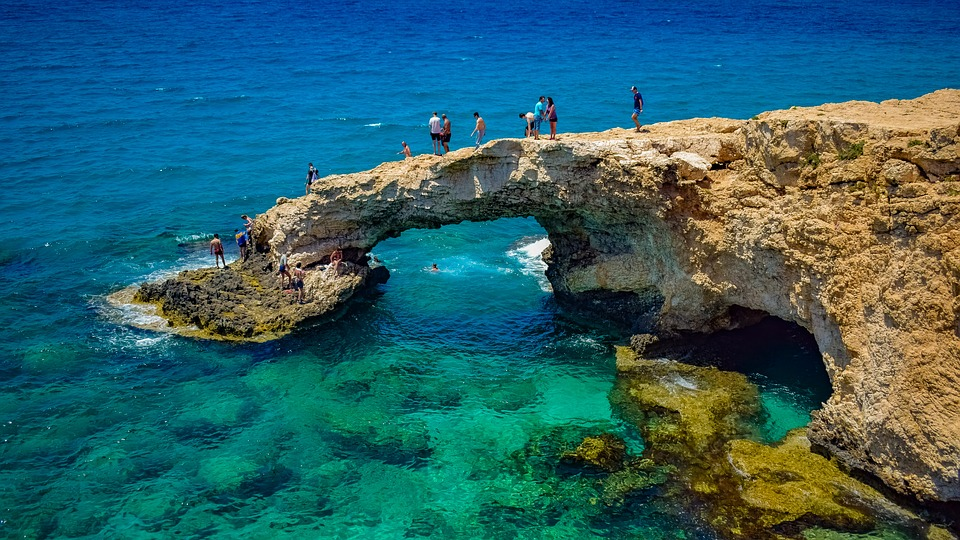 Clear turquoise waters surrounding the famous naturally formed Cyprus Love Bridge
