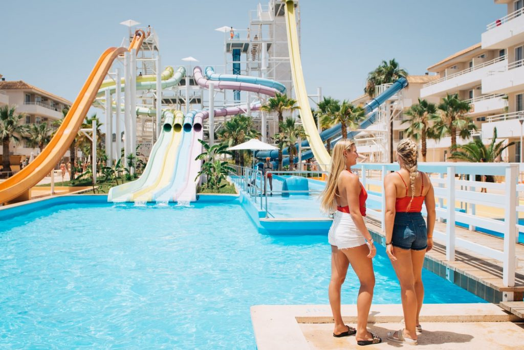Two girls chatting by the Pool at the BH Mallorca Hotel WaterPark in Magaluf