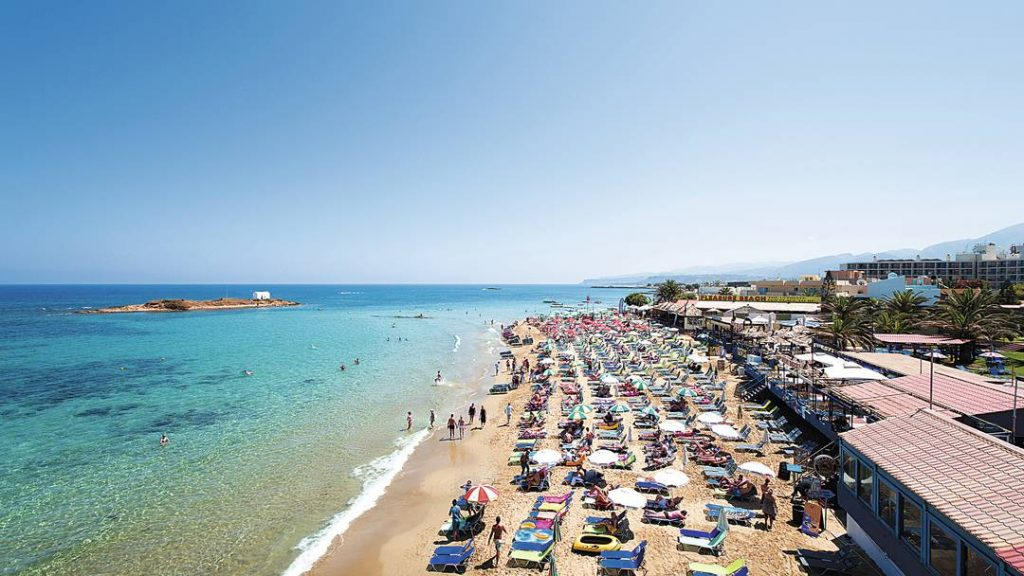 Blue sea, blue skys and sunbeds on Malia Beach