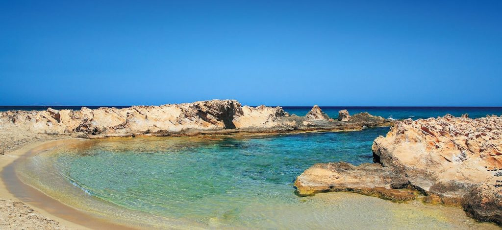 Picturesque rocky cove at Malia's tranquil Potamos Beach