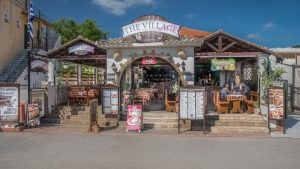 outside view of the village restaurant in kavos