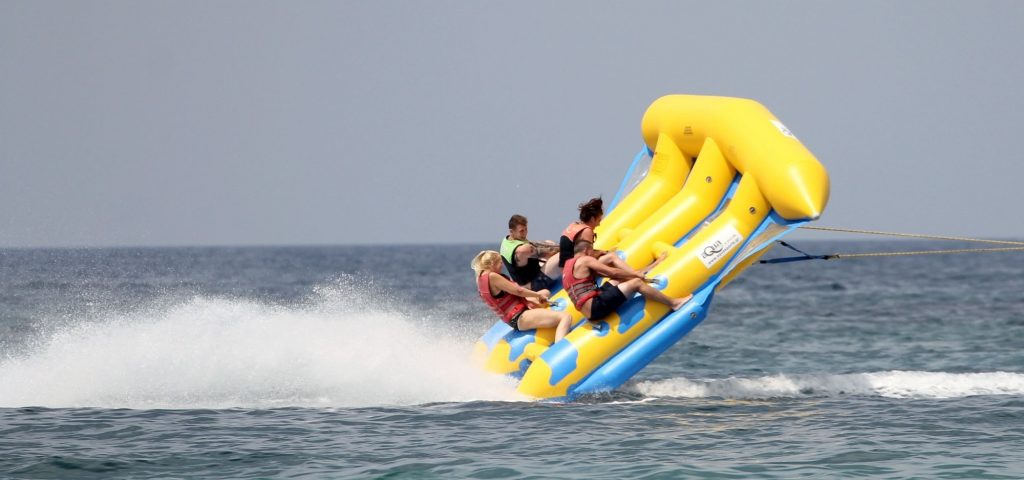 watersports in malia yellow inflatable in midair