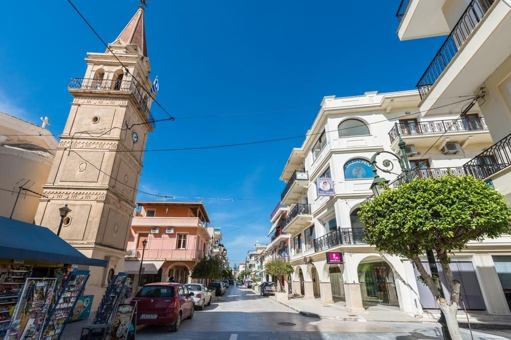 Blue summer sky over colourful street in zakynthos town